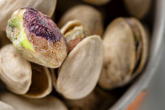 Pistachios. A bowl of sicilian pistachios for a snack, macro shot Stock Photos