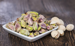 Pistachios in a bowl (on wood) Stock Photo
