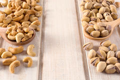 Pistachios and cashew nuts Stock Photo