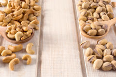 Pistachios and cashew nuts Royalty Free Stock Images