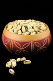 Pistachios in a ceramic bowl Stock Images