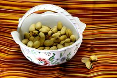 Pistachios in a ceramic vase. Royalty Free Stock Photo