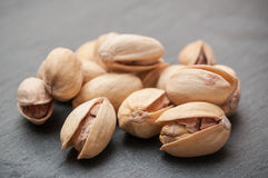 Pistachios on chalkboard background. Closeup of pistachios on chalkboard background stock photography