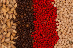 Pistachios, chickpeas, roasted coffee beans and dried rowan berries. Different colors of healthy food. Territory taste. Grains,  kernels and berries Stock Photography