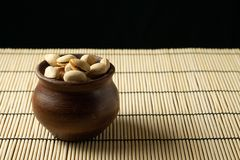Pistachios in a clay bowl on the table stock photos