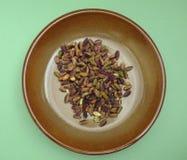Pistachios in a dish Stock Photos