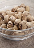 Pistachios in a glass bowl. Close up photo Royalty Free Stock Images