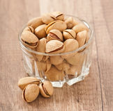 Pistachios in a glass bowl Royalty Free Stock Images