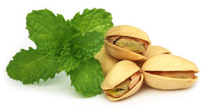 Pistachios with green mint leaves Royalty Free Stock Image