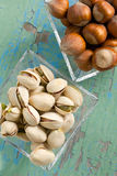 Pistachios and hazelnuts Stock Photography