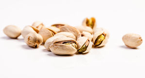 Pistachios isolated on white. Pistachios nuts isolated on white royalty free stock photos
