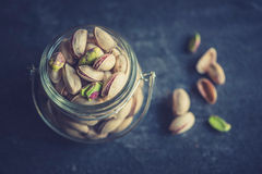 Pistachios in the jar Royalty Free Stock Photos