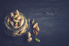 Pistachios in the jar Royalty Free Stock Images