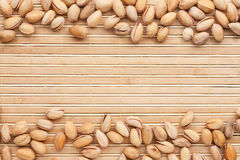 Pistachios  lies on the a bamboo mat Royalty Free Stock Image