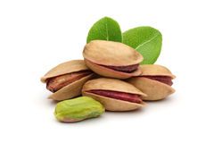 Pistachios nuts. Pistachios and leaves on white background Stock Photography
