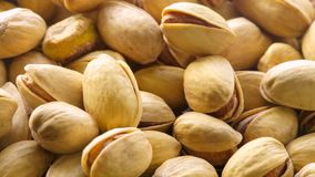 Pistachios. Nuts close - up video in high quality. Slow camera movement, smooth background rotation with nuts stock video