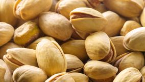 Pistachios. Nuts close - up video in high quality. Slow camera movement, smooth vertical panorama from bottom to top stock footage