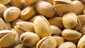 Pistachios. Nuts close - up video in high quality. Slow motion camera, horizontal panorama from right to left stock footage