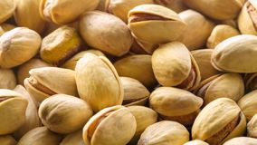 Pistachios. Nuts close-up video in high quality Slow motion camera. Approaching background with nuts stock video footage