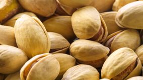 Pistachios. Nuts close - up video in high quality. Slow motion camera, smooth out from the background stock video footage