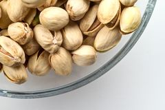 Pistachios nuts in glass bowl Royalty Free Stock Image