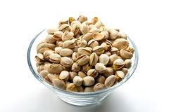 Pistachios nuts in glass bowl Stock Photos