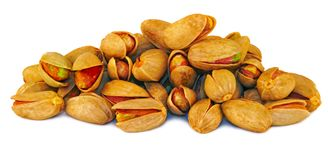 Pistachios nuts over white. Isolated Pistachios nuts on a white background Stock Images