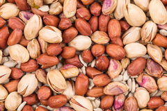 Pistachios with peanuts and sunflower seeds. Stock Photos