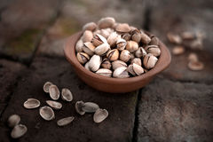 Pistachios on pot Royalty Free Stock Image