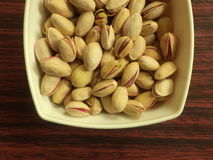 Pistachios. Salted pistachios inside a plastic bowl Royalty Free Stock Photos