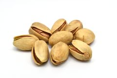 Pistachios and shadow isolated on white background. stock photography
