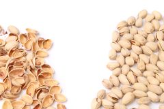 Pistachios and shells. Are located on opposite sides of the frame Stock Photo