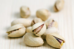 Pistachios. On the table, closeup. Selective focus Royalty Free Stock Photography