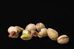 Pistachios (Without TEXT). Black background with Pistachios at bottom of image royalty free stock photography