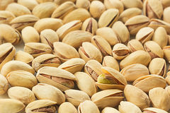 The pistachios on white background. Royalty Free Stock Images