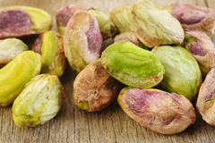 Pistachios on wooden background Royalty Free Stock Images