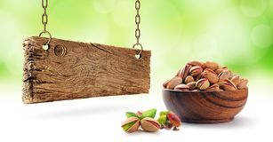 Pistachios and wooden board stock photo