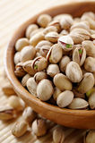 Pistachios. Wooden bowl full of Pistachios Stock Images