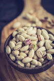Pistachios in wooden bowl Royalty Free Stock Images