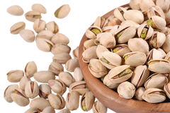 Pistachios in a wooden bowl on a white background Royalty Free Stock Photo