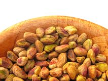Pistachios in wooden dish Royalty Free Stock Image