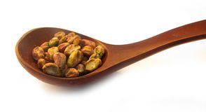 Pistachios in wooden dish Royalty Free Stock Photography