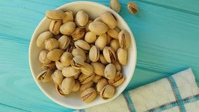 Pistachios health kernel towel slow-motion shakes shot group appetizer plate background. Pistachios wooden plate appetizer health food kernel fall tasty table stock video footage