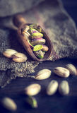 Pistachios in wooden scoop Royalty Free Stock Images