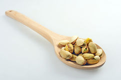 Pistachios in a wooden spoon. Stock Photos