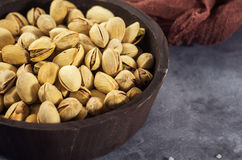 Pistachios in a wooden spoon. Selective focus. Close up royalty free stock image