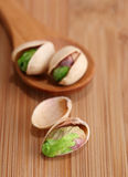 Pistachios on wooden table. Selective focus Royalty Free Stock Images