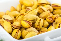 Pistachios in yellow shells roasted with saffron stock photo