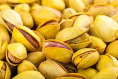 Pistachios in yellow shells roasted with saffron. Food background royalty free stock images