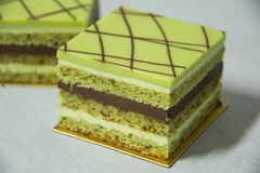 Pistacho layer cake and chocolate garnache Royalty Free Stock Images